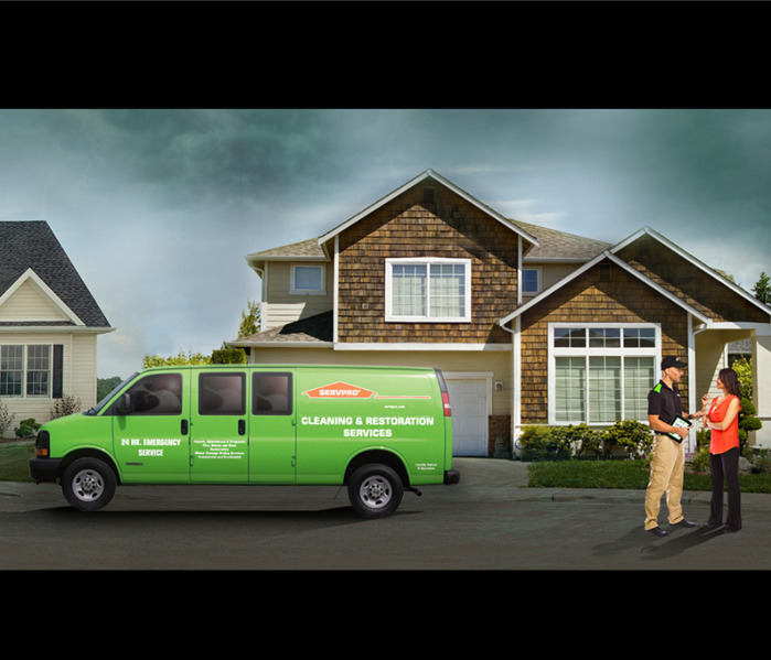 house with servpro van out front