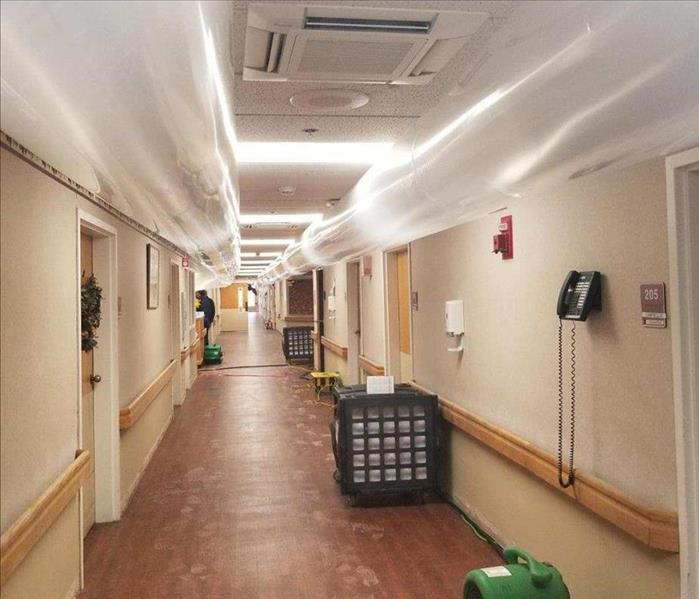 long hallway in nursing home with ventilation ducts set up