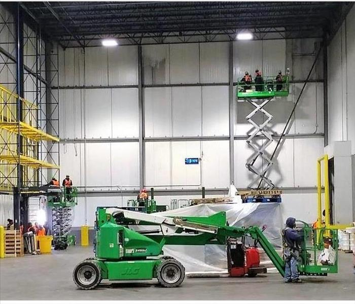 warehouse with servpro crew cleaning